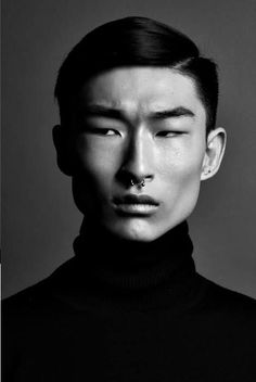 Make model in black turtle neck sweater. Black and white fashion photography: