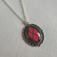 Harley Quinn necklace  Made by securely sandwiching an image between a silver…