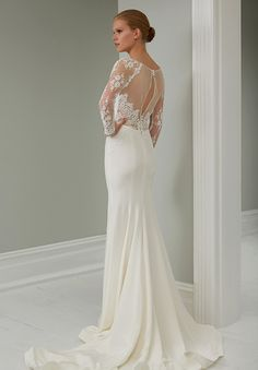 Sheer back wedding dress with long sleeves. STEVEN KHALIL 2015 RTW COLLECTION