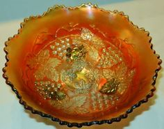 To price the items and view our other outstanding offerings, we invite you to visit our online store located at http://www.longbrookantiques.com  FENTON CARNIVAL GLASS POWDER BLUE & MARIGOLD 3 FOOTED GRAPE & CABLE BOWL