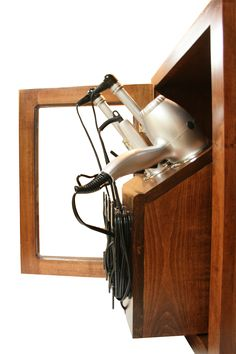 The Caddy, designed for wall or tower cabinets, stores all your hair tools like a salon...but in your home.
