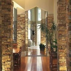 Stone veneers or stone tiles give you the look of high-end masonry work. Stone veneer over the wall creates more unique look with variation of design and color. Stone veneer wall is quite interesting as additional feature at your home. Interior Window Trim, Interior Columns, Stone Interior, Columns Decor, Faux Brick Panels, Brick Paneling, Stone Veneer Panels, Columns Inside, Wall Design