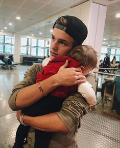 Idk who this guy is but he's cute aaaand he's holding an adorable baby<<<that's Alex Lange he's hot af
