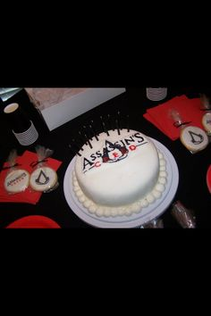 Assassin's Creed III Birthday Cake and love the little cookies with it.