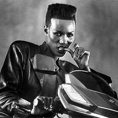 Grace Jones on a motorcycle in a masculine leather jacket. Find a killer motorcycle jacket for shoot