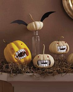 Mini pumpkins with those plastic vampire teeth and red pins for eyes.