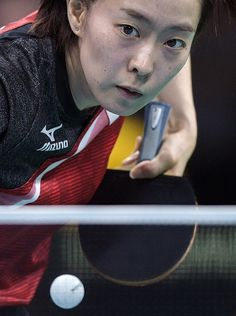 Japan's Kasumi Ishikawa hits a shot in her women's singles qualification round table tennis match at the Riocentro venue during the Rio 2016 Olympic...