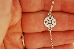 http://www.etsy.com/listing/106554762/compass-bracelet?ref=shop_home_active   I love this bracelet!!