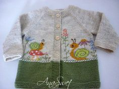 Baby cardigan with snails and flowers.