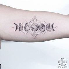 Moon phases tattoo on the left inner arm.