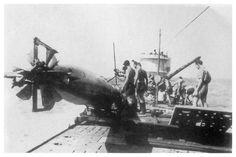 U-172 taking on a torpedo