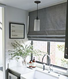 roman flat shade with continuous cord loop | The Different Types Of Window Treatments: Styles of Roman Shades