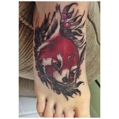 Red panda tattoo.