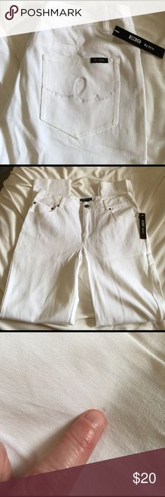 White skinny jeans size 6 Bright White stretch skinny jeans new with tags. They have great stretch and inseam is 29. From being in the closet they have a few spots on them but not real noticeable. E39 by Eric Jeans Skinny