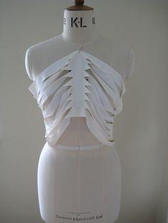 Draping experiments to create a slash & cut skeletal top - pattern cutting; skeleton fashion design; garment structure development // Suzanna Tite