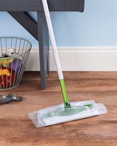 Wax paper instead of Swiffer refills!  Rip off a piece roughly the size of your sweeper and attach it just as you would a cleaning cloth. As you sweep highly trafficked or dirty areas, the gunk sticks. Wax on, dirt off!