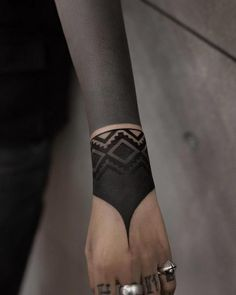 These Striking Solid Black Tattoos Will Make You Want To Go All In - KickAss Things - beautiful blackout tattoo ideas for women 💕💕💕💕 - Black Line Tattoo, Solid Black Tattoo, Black Tattoos, Blackout Tattoo, Hand Tattoos, Body Art Tattoos, Maori Tattoos, Tattos, Diy Tattoo