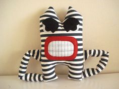 Angry monster fun!, Is made of canvas navy blue and white stripes. It has big black eyes and felt angry at white. His mouth has large teeth felt.