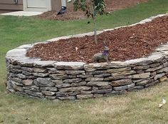 Use our rustic and beautiful Thin Veneer Fieldstone as a flat veneer on your fireplace or chimney, or use it to construct a dry stack retaining wall.