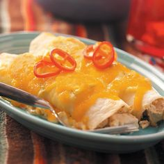 Creamy Chicken Enchiladas Recipe -My daughter, Lisa Sand, brought 10 pans of these yummy chicken enchiladas to my wedding reception and they were the biggest hit of all the food. So many guests wanted the recipe, we sent it out with our Christmas cards. —Pat Coffee, Kingston, Washington