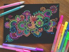 Gelly roll pen doodle/zentangle by Simran Savadia - Neon colours on black paper, so vibrant!