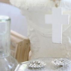 Photography by my friend Erin Anderson. Location: Gilchrist & Gilchrist, Nashville. Don't you just LOVE the simplicity/purity of the cross juxtaposed w/ the sparkly baubles? Then there's the wood element ... the water glass ... my oh my ... talk about speaking a thousand words!