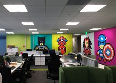 office workers install 8-bit superhero mural using 8,024 sticky notes