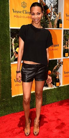 ZOË SALDANA  Someone's been reading our Red Carpet Trend Report! The actress attends the fifth annual Veuve Clicquot Polo Classic in Jersey City, NJ, sporting of-the-moment leather hot pants and a cropped tee (both by Theyskens' Theory), plus Irene Neuwirth gems and cognac sandals.
