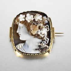 late century onyx cameo brooch, by Morelli Finely carved to depict the head of Bacchus, mounted in yellow gold. A skilled cameo artist uses the different colored bands in a stone like onyx to create lifelike portraits with great depth and detail! Cameo Jewelry, Antique Jewelry, Jewelry Box, Jewelery, Vintage Jewelry, Fine Jewelry, Bijou Box, Sculpture, Bling