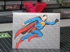You may not know, but I also teach crafting to children. My #1 student is my 7 year old daughter Zora. We always make cards for her classmates when she is invited to a party. We've had a bunch of invites in the last few weeks. I always ask her about her classmate and what she thinks they may like. This time she chose Superman. I cut the items from the Superman Cricut Cartridge for her but she used the xyron to make the layers into stickers and assembled the die cuts. She is also very handy…