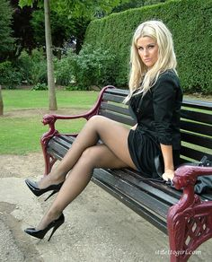 A foxy blonde on a bench in black stilettos and sheer black pantyhose...