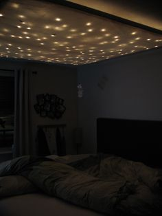 Mood lighting w/ xmas lights and fabric (http://www.reddit.com/r/DIY/comments/e2an4/i_just_replaced_the_lights_in_my_living_room_it/)