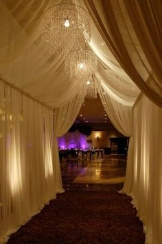Entertaining wedding reception party celebration entry white sheer drapes curtains with crystal chandelier