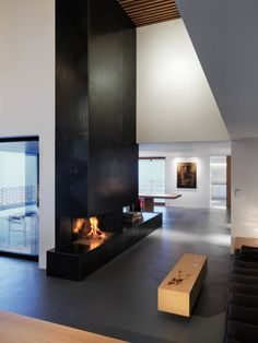 Ralph Germann architectes have designed the Alpine House in Fribourg, Switzerland. This alpine house was designed for a couple who wished to live in a harm Metal Fireplace, Home Fireplace, Modern Fireplace, Fireplace Surrounds, Fireplace Design, Fireplaces, Black Fireplace, Fireplace Ideas, Fireplace Candles