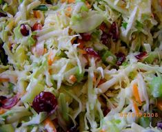 Coleslaw with pineapple, craisins, and granny smiths. Sounds awesome! (Perhaps with tomorrow night's fish tacos...mmmmmm!)