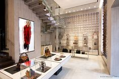 Beautiful mixture of glass/stainless steel with wild textiles (JUST CAVALLI flagship store, Milan)