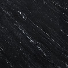 Ocean Black Honed Granite Countertops In White Kitchen