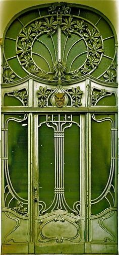 [This looks to me like a transitional style between the super-decorative lines of Art Nouveau and the geometric emphasis of Art Deco.] Green and Art Nouveau.