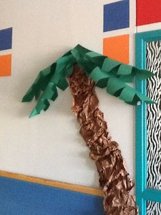 How to make a palm tree for a tropical or jungle themed bulletin board.