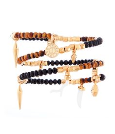 St. Tropez Charm Coil Bracelet   Gone Native   Henri Bendel