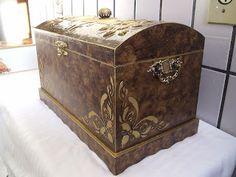 http://artemcasasonia.blogspot.com.br/2009/04/baus-em-madeira.html