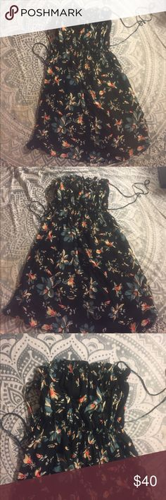 Free people black floral babydoll smocked dress to New without tags (tag detached) intimately Free People long tank top dress in a summer ready floral all over print. Top has an elastic smocked effect. Straps can be adjusted. Size medium. No trades. Free People Dresses Mini