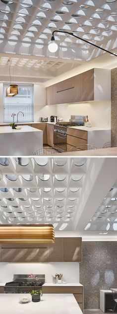 This modern house in London has a unique floor made from pavement lights that have been re-purposed to allow natural light to fill the two levels of the house.