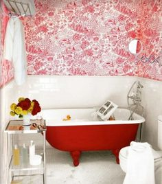 Here the wallpaper takes center stage with this colored tub. Consider replacing your tub space with a refurbished and painted claw-footed tub.