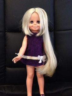 Crissy Velvet Doll 1970. My sister had one of these dolls, you pull it's hair and then push the button on its tummy