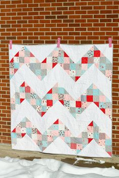 Patchwork Chevron quilt tutorial. I'd probably just use a patterned fabric instead of doing the patchwork part! Looks easy to make