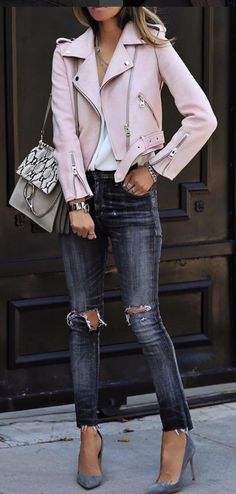 Breathless. This is the most gorgeous light pink moto jacket. Saw it called suede, reads as leather. In any case, the finish is flawless and the details are elegantly rendered. Wide collar, minimal studs, zippers, belt and buckle. Worn with distressed jeans, croc shoulder bag and gray suede pumps. Bracelets, rings. Style Planet