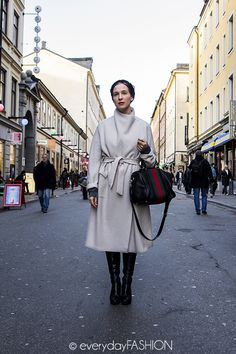 """White coat, black boots, Gucci bag.  A standard Tracy uniform. From """"Killing Me Softly,"""" a novel of psychological suspense by Bianca Sloane."""