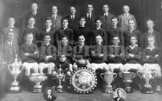 The 1921-22 team, Linfield's first seven trophy side, winners of the Irish Cup, Charity Cup, Irish League, Co.Antrim Sheild, Gibson Cup, Gold Cup and Alhambra Cup.  They are back row - S. Thompson, D. Emerson, W. Whitten, T. Chambers, (chairman), D. Hunter, R. Dunn. Centre row - J. Peden, W. Savage, A. McIlreavy, T. Frame, A. Harland, T. Cowan, G. Morgan, A. Mautlsaid, and J. Brown (secretary). Front row - J. Torrans (treasurer), M. Scott, D. Gunning, J. Campbell, R. Wallace (captain), R…