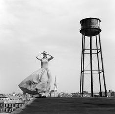 Rodney Smith: Viktoria standing on roof near water tower, Brooklyn, NY Magritte, Great Photographers, Portrait Photographers, Couple S'embrassant, Rodney Smith, Brooklyn, Water Tower, Japanese Artists, Will Smith